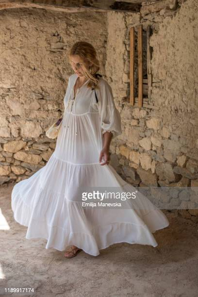 carefree young woman spinning with her white dress - white dress stock pictures, royalty-free photos & images