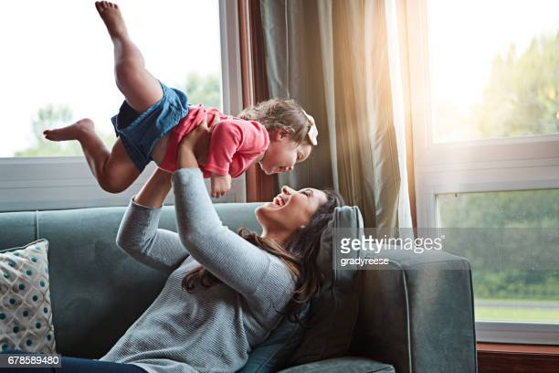 careful! don't fly away from me now - happy family stock photos and pictures
