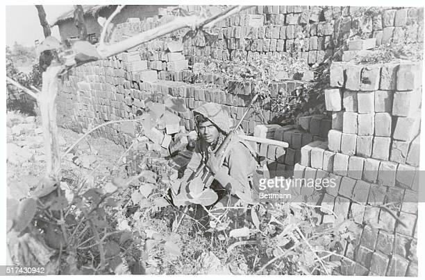 Careful Jessore East Pakistan An Indian soldier takes shelter behind a wall during an artillery attack by Pakistani soldiers near here India said it...