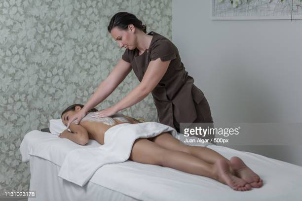 careful woman giving professional massage - psychiatrist's couch stock pictures, royalty-free photos & images