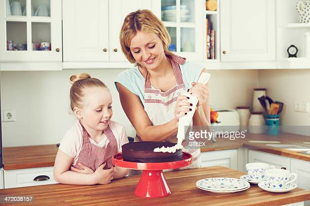 carefully icing the cake - decorating a cake stock pictures, royalty-free photos & images