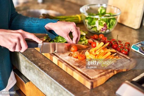 Carefully preparing her ingredients