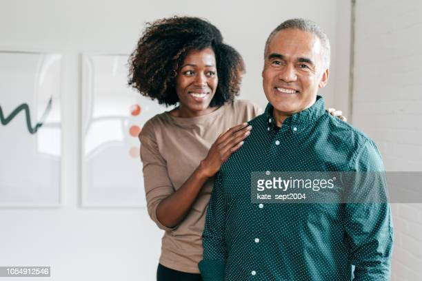 caregiver and patient in recuperation - stroke stock pictures, royalty-free photos & images