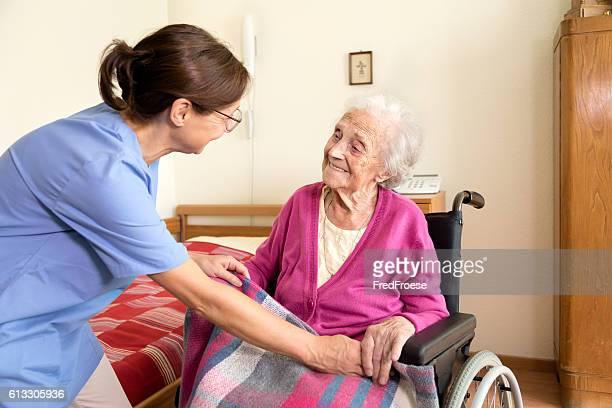 Caregiver and senior patient at nursing home