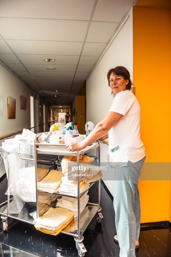 Caregiver At The nursing Home Transporting Medical  Supplies : Stock Photo