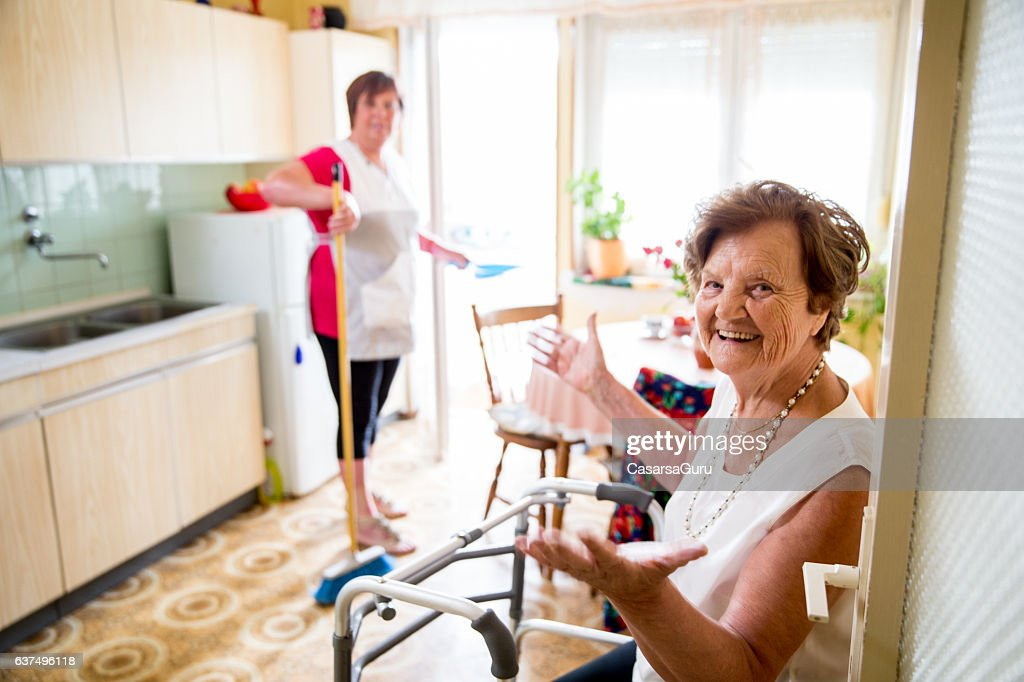 Caregiver Doing the Chores : Stock Photo
