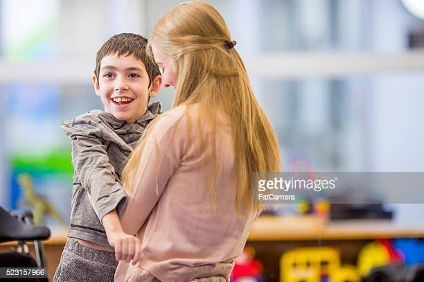 Caregiver Helping a Disabled Child