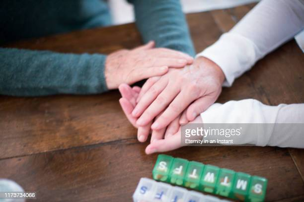 cu caregiver holding senior women's hands - healthcare stock pictures, royalty-free photos & images