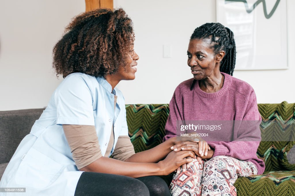 Caregiver in  a retirement home : Stock Photo