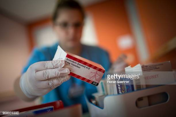 A caregiver takes medicines out of a box on April 27 2018 in Berlin Germany