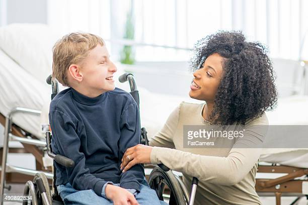 Caregiver Talking to Little Boy