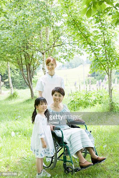 Caregiver with senior woman and her granddaughter
