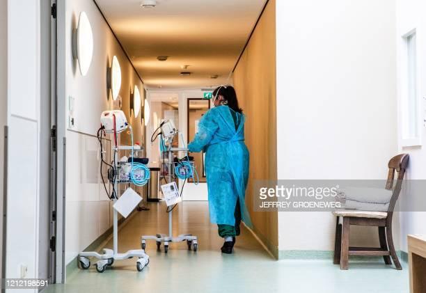 Caregiver works in a nursing home in Nieuw Rijsenburgh district in Sommelsdijk, the Netherlands, on May 8, 2020. - Healthcare workers must wear...