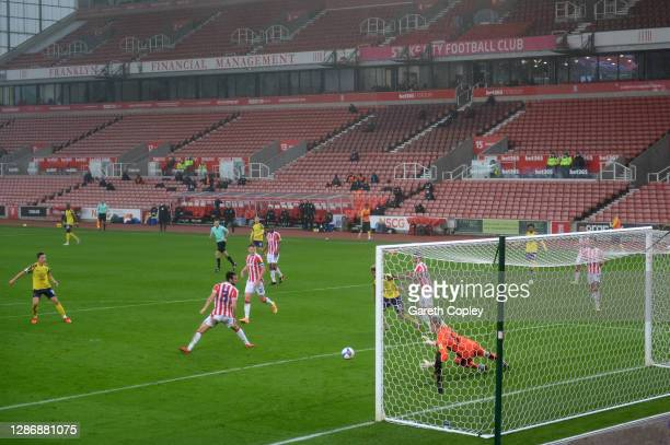 Carel Eiting of Huddersfield Town scores his team's first goal during the Sky Bet Championship match between Stoke City and Huddersfield Town at...
