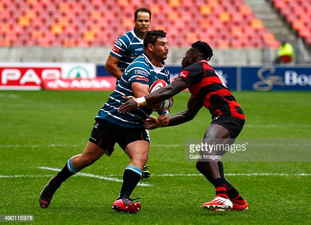 Carel Greeff of Griquas is tackled by Luther Obi of the EP Kings during the Absa Currie Cup match between Eastern Province Kings and ORC Griquas at...