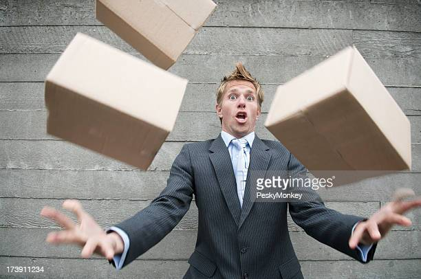 Careless Man Dropping Delivery of Brown Boxes Outdoors