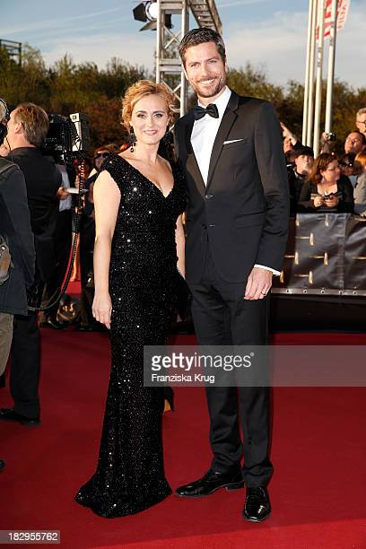 Caren Miosga and Ingo Zamperoni attend the Deutscher Fernsehpreis 2013 - Red Carpet Arrivals at Coloneum on October 02, 2013 in Cologne, Germany.