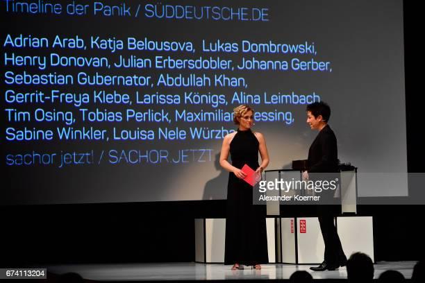 Caren Miosga and jury member Dunja Hayali speak on stage at the Nannen Award 2017 on April 27 2017 in Hamburg Germany