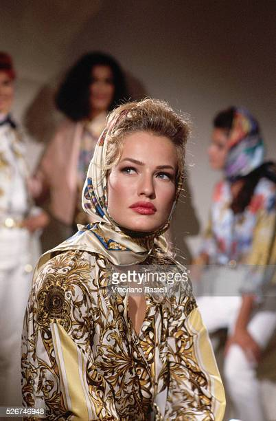 Caren Multen models clothes by Versace on a catwalk in Milan.