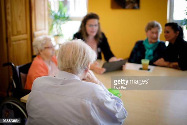 Carer in conversation with residents of a nursing home on April 27 2018 in Berlin Germany