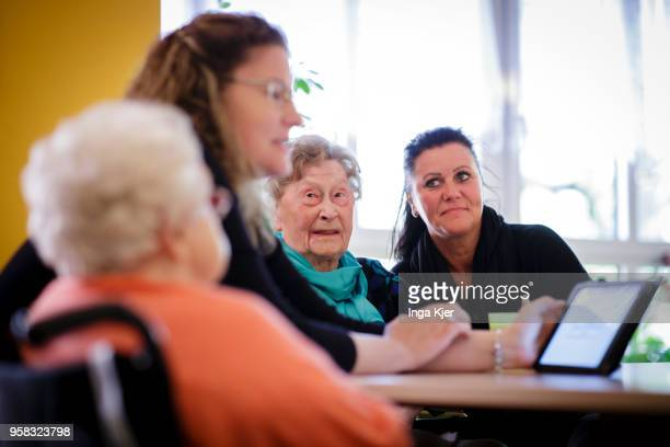 Carers in conversation with residents of a nursing home on April 27 2018 in Berlin Germany