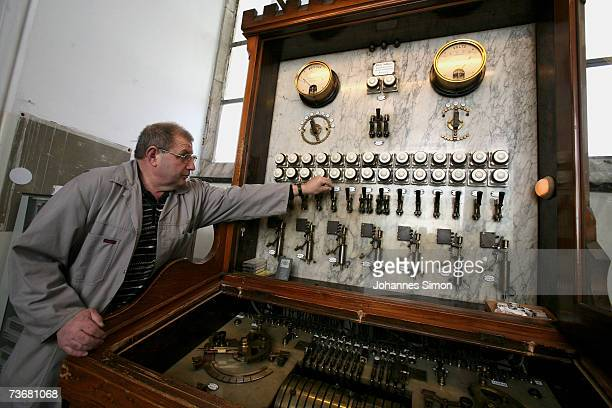 Caretaker Christian Schmidmeier activates the 19th century main switch table of the carillon in the new townhall at the Marienplatz on March 23 2007...
