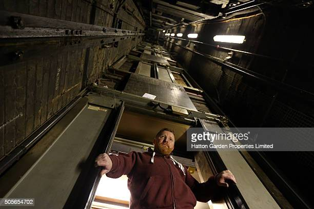Caretaker looks in the lift shaft used to access the underground vault of the Hatton Garden Safe Deposit Company which was raided in what has been...