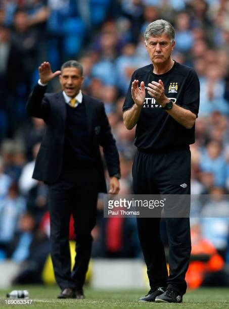 Caretaker manager Brian Kidd of Manchester City claps during the Barclays Premier League match between Manchester City and Norwich City at the Etihad...