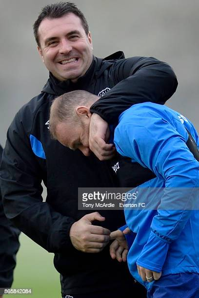 Caretaker manager David Unsworth of Everton welcomes Wayne Rooney onto the training pitch during the Everton training session at USM Finch Farm on...