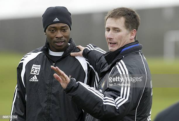 Caretaker Manager Glenn Roeder instructs Shola Ameobi during the training session ahead of the FA Cup 5th round tie between Newcastle United and...