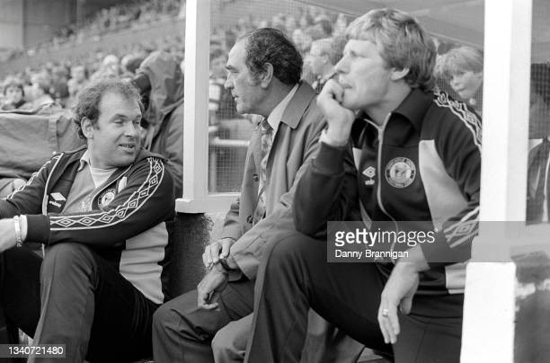 Caretaker manager Joe Harvey pictured with physio Brian Collins and First team coach Willie McFaul on the bench before a Second Division match...