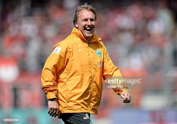Caretaker manager Mathias Hoenerbach of Bremen laughs during the warm up prior to the Bundesliga match between 1 FC Nuernberg and SV Werder Bremen at...