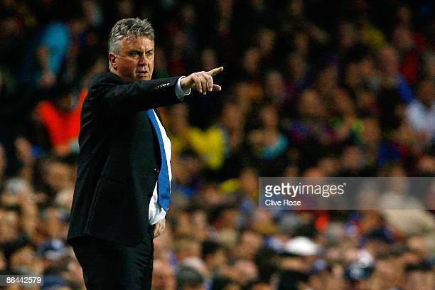 Caretaker manager of Chelsea Guus Hiddink gestures during the UEFA Champions League Semi Final Second Leg match between Chelsea and Barcelona at...