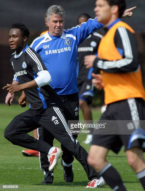 Caretaker manager of Chelsea Guus Hiddink gives instructions during a training session at the Chelsea FC training ground on April 21, 2009 in Cobham,...