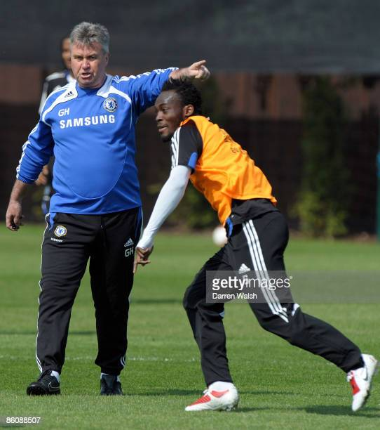 Caretaker manager of Chelsea Guus Hiddink gives instructions to Michael Essien during a training session at the Chelsea training ground on April 21,...