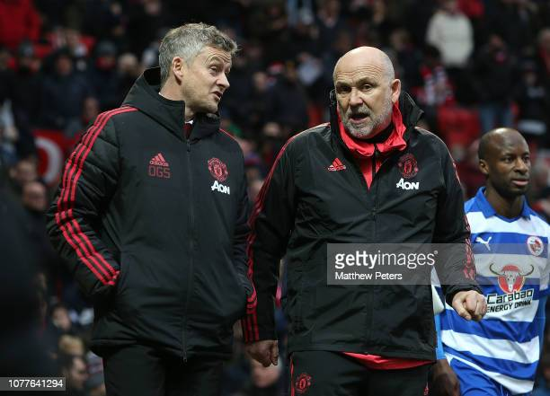 Caretaker Manager Ole Gunnar Solskjaer and Coach Mike Phelan of Manchester United walk out for the second half during the FA Cup Third Round match...