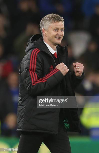 Caretaker Manager Ole Gunnar Solskjaer of Manchester United celebrates after the Premier League match between Cardiff City and Manchester United at...