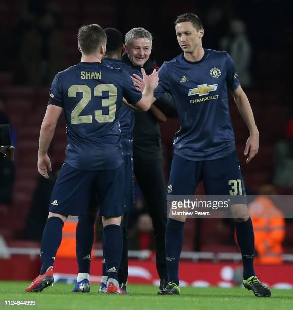 Caretaker Manager Ole Gunnar Solskjaer of Manchester United celebrates after the FA Cup Fourth Round match between Arsenal and Manchester United at...