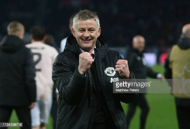 Caretaker Manager Ole Gunnar Solskjaer of Manchester United celebrates at the final whistle during the UEFA Champions League Round of 16 Second Leg...