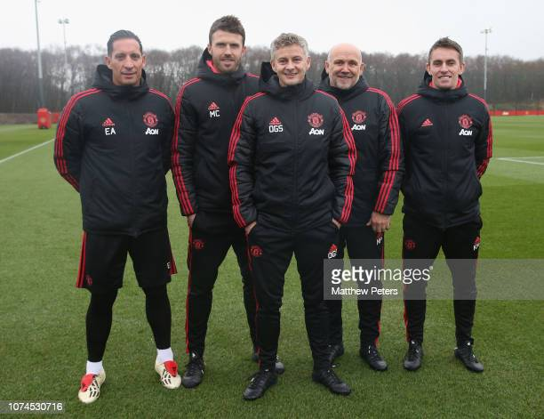 Caretaker Manager Ole Gunnar Solskjaer of Manchester United poses with coaches Emilio Alvarez Michael Carrick Mike Phelan and Kieran McKenna at Aon...