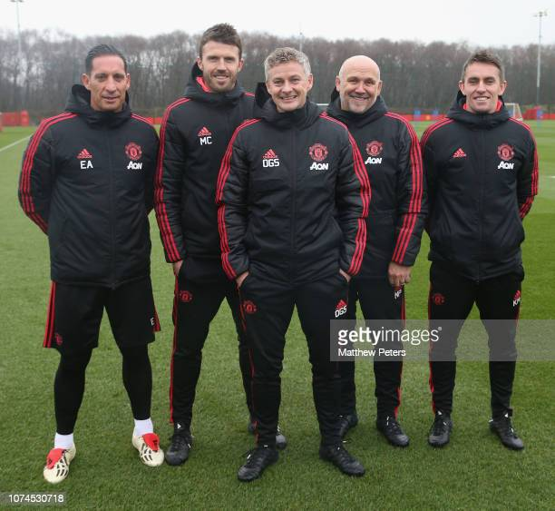 Caretaker Manager Ole Gunnar Solskjaer of Manchester United poses with coaches Emilio Alvarez Michael Carrick Mike Phelan and Kieran McKenna at Aon...