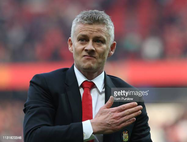 Caretaker Manager Ole Gunnar Solskjaer of Manchester United walks off after the Premier League match between Manchester United and Liverpool FC at...