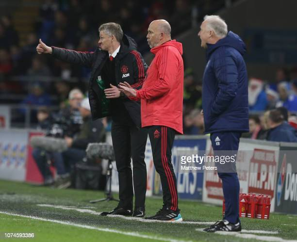 Caretaker Manager Ole Gunnar Solskjaer of Manchester United watches from the touchline during the Premier League match between Cardiff City and...