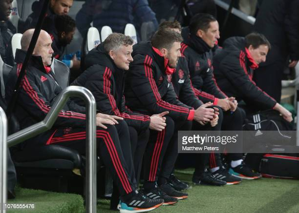 Caretaker Manager Ole Gunnar Solskjaer of Manchester United watches from the dugout during the Premier League match between Newcastle United and...