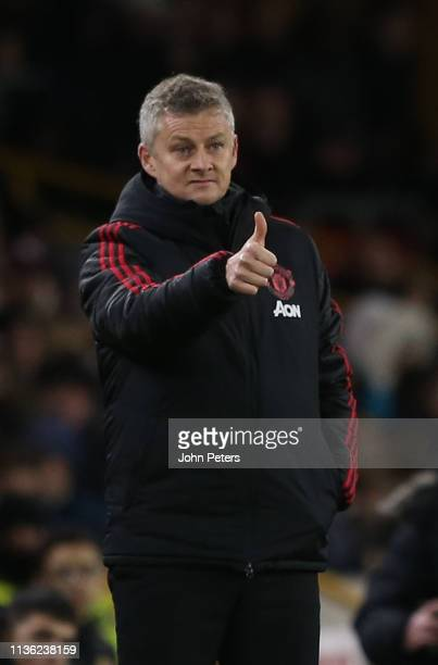 Caretaker Manager Ole Gunnar Solskjaer of Manchester United watches from the touchline during the FA Cup Quarter Final match between Wolverhampton...