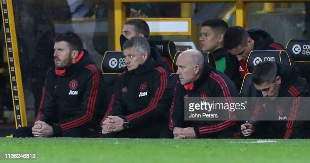 Caretaker Manager Ole Gunnar Solskjaer of Manchester United watches from the dugout during the FA Cup Quarter Final match between Wolverhampton...
