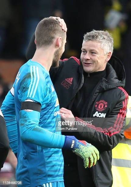 Caretaker Manager Ole Gunnar Solskjaer of Manchester United celebrates with David de Gea after the Premier League match between Fulham FC and...