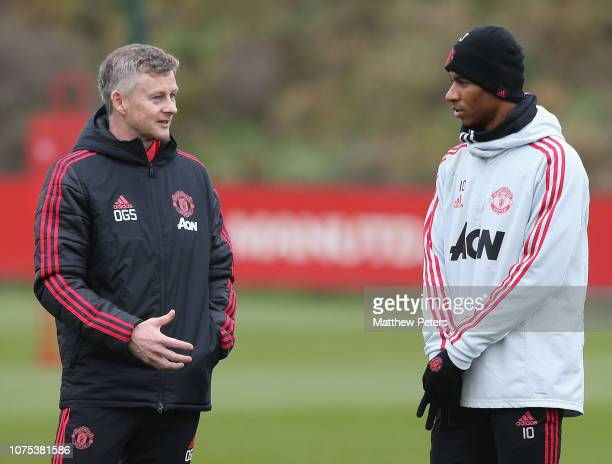 Caretaker Manager Ole Gunnar Solskjaer speaks to Marcus Rashford of Manchester United in action during a first team training session at Aon Training...