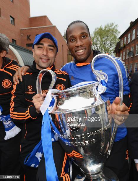 Caretaker manager Roberto Di Matteo and Didier Drogba pose with the Champions League trophy during the Chelsea victory parade following their UEFA...