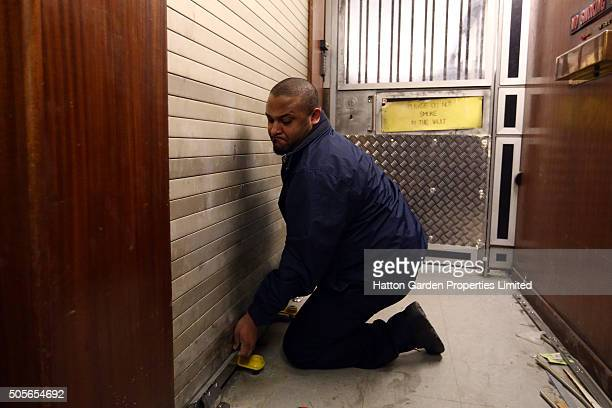 Caretaker opens the shutter to the lift shaft used to access the underground vault of the Hatton Garden Safe Deposit Company which was raided in what...
